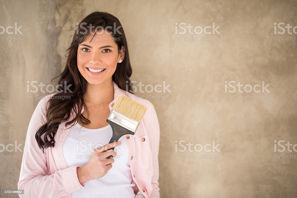 Woman painting a wall stock photo