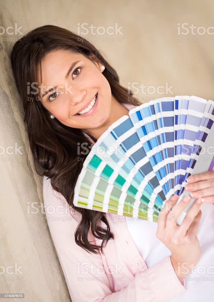 Woman painting her house stock photo