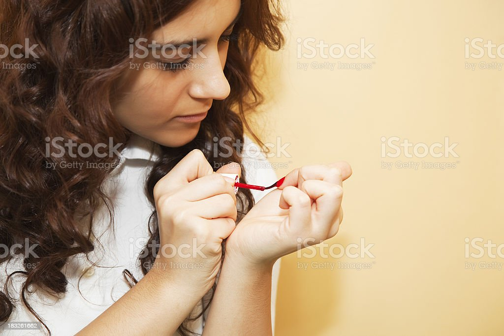Woman Painting Nail Polish stock photo