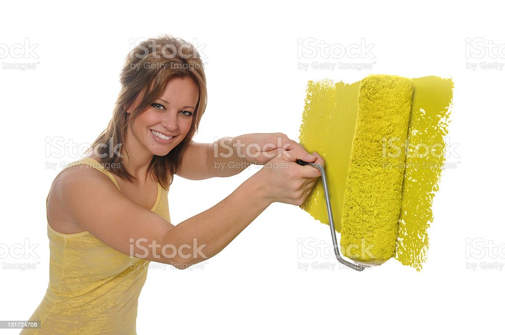 Woman painting the wall with a paint roller royalty-free stock photo