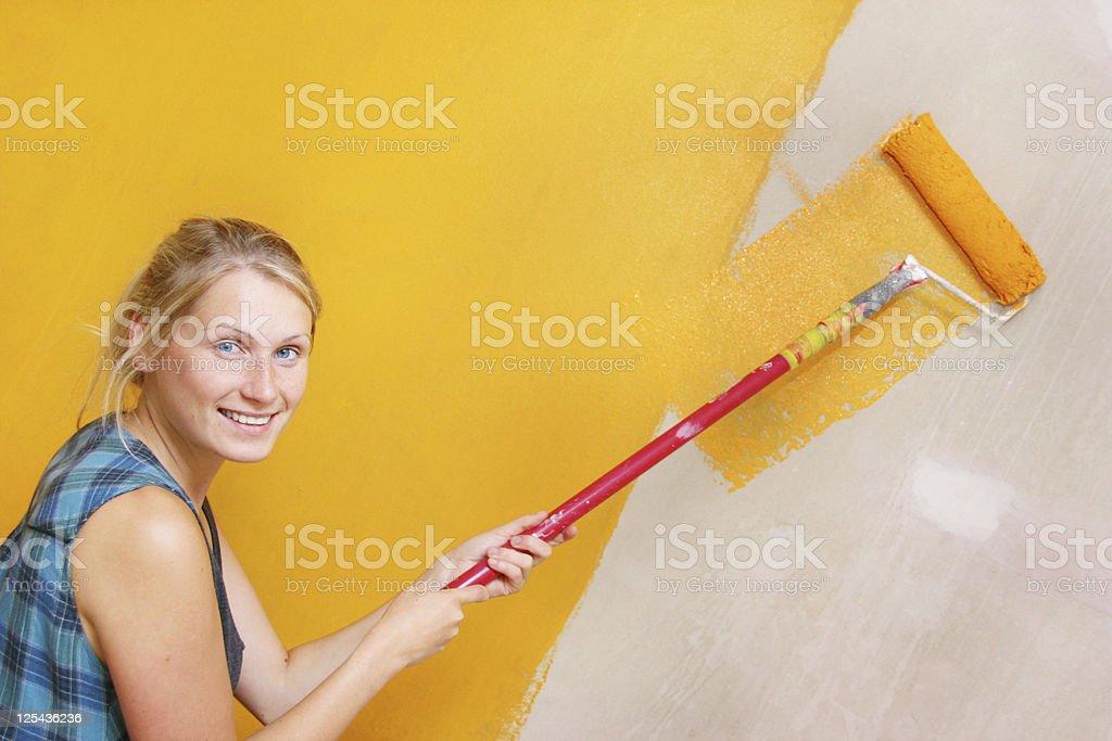 woman painting wall royalty-free stock photo