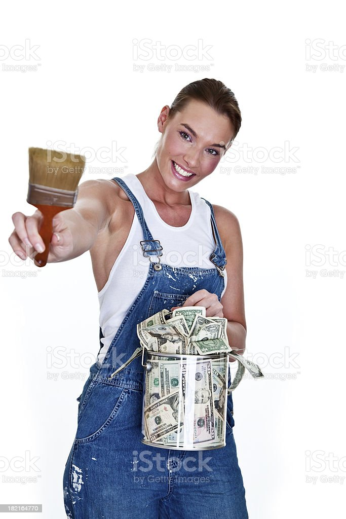 Woman painting with can of money royalty-free stock photo