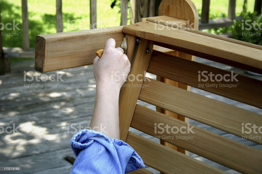 Woman Painting Wooden Chair royalty-free stock photo