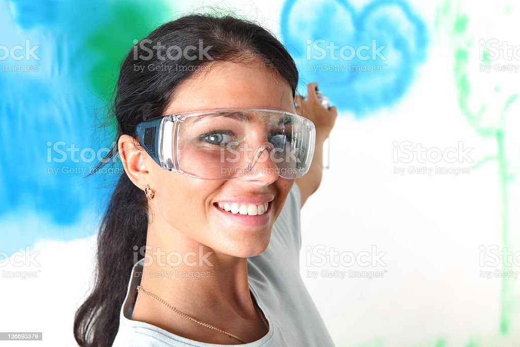 woman paints the wall stock photo