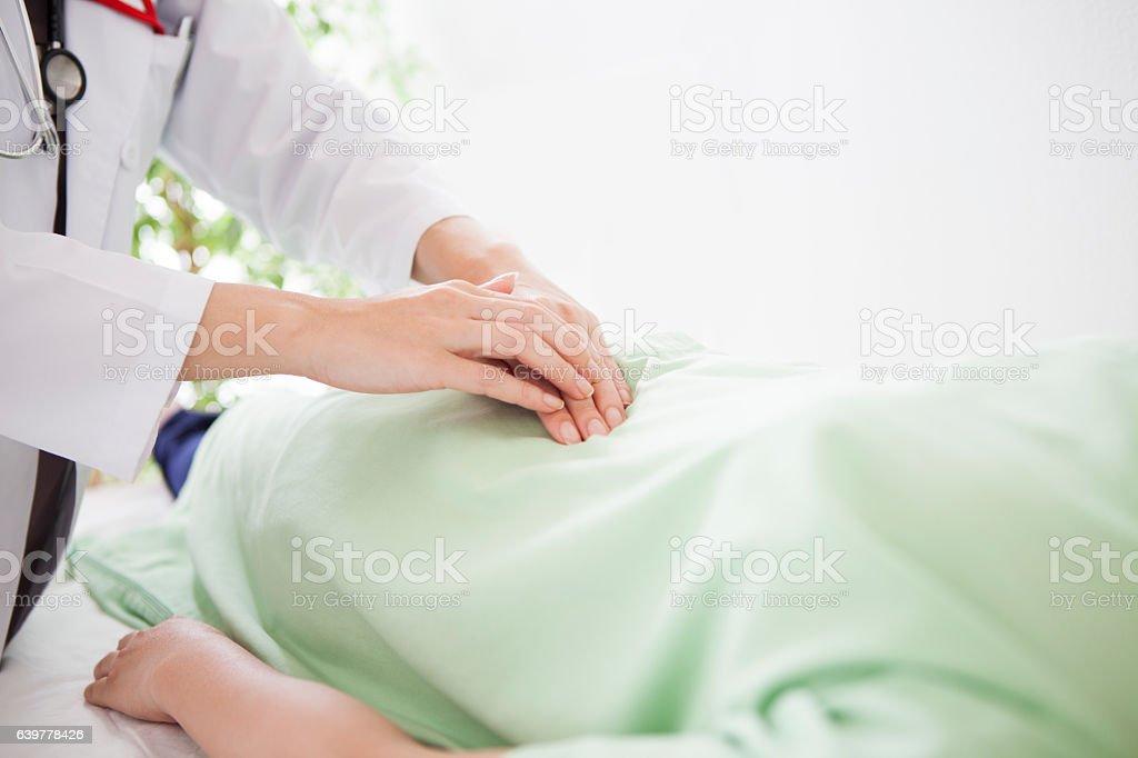 Woman palpating at a hospital stock photo