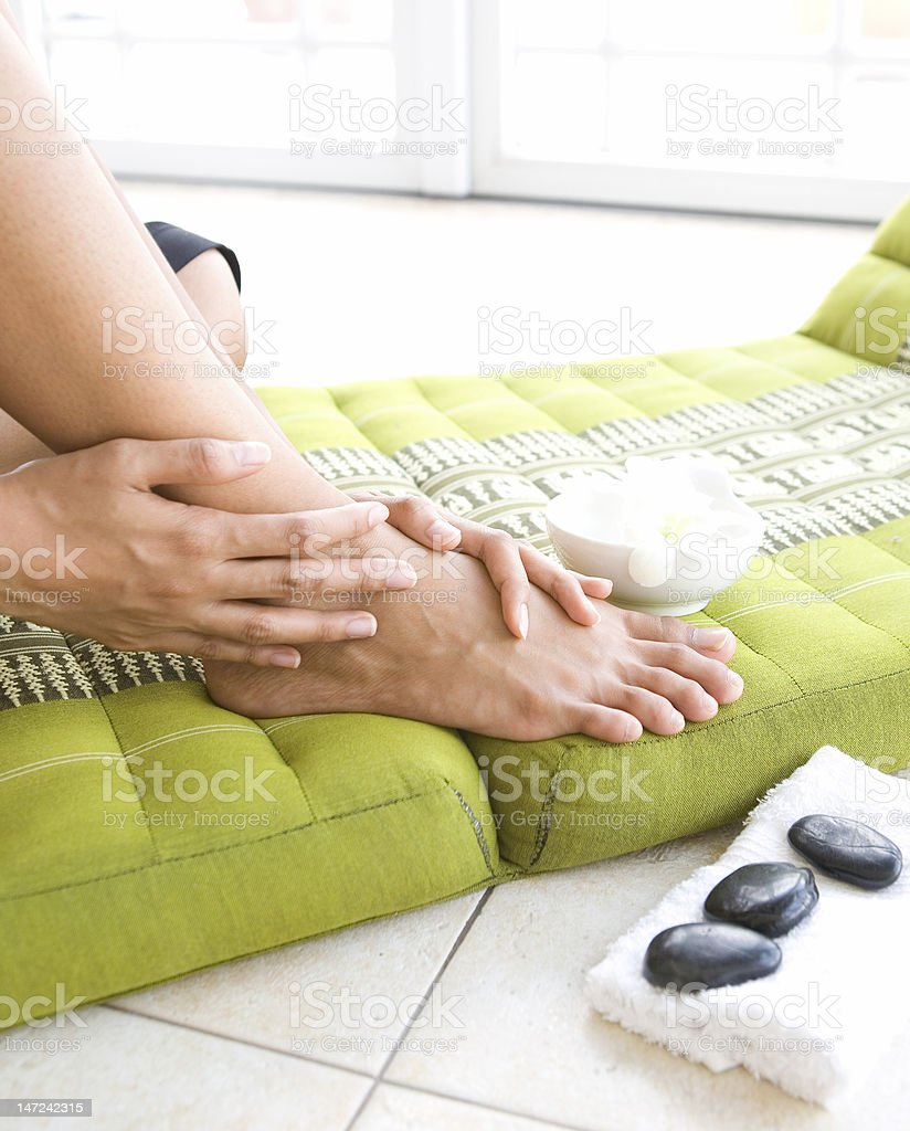 Woman pampering her feet royalty-free stock photo