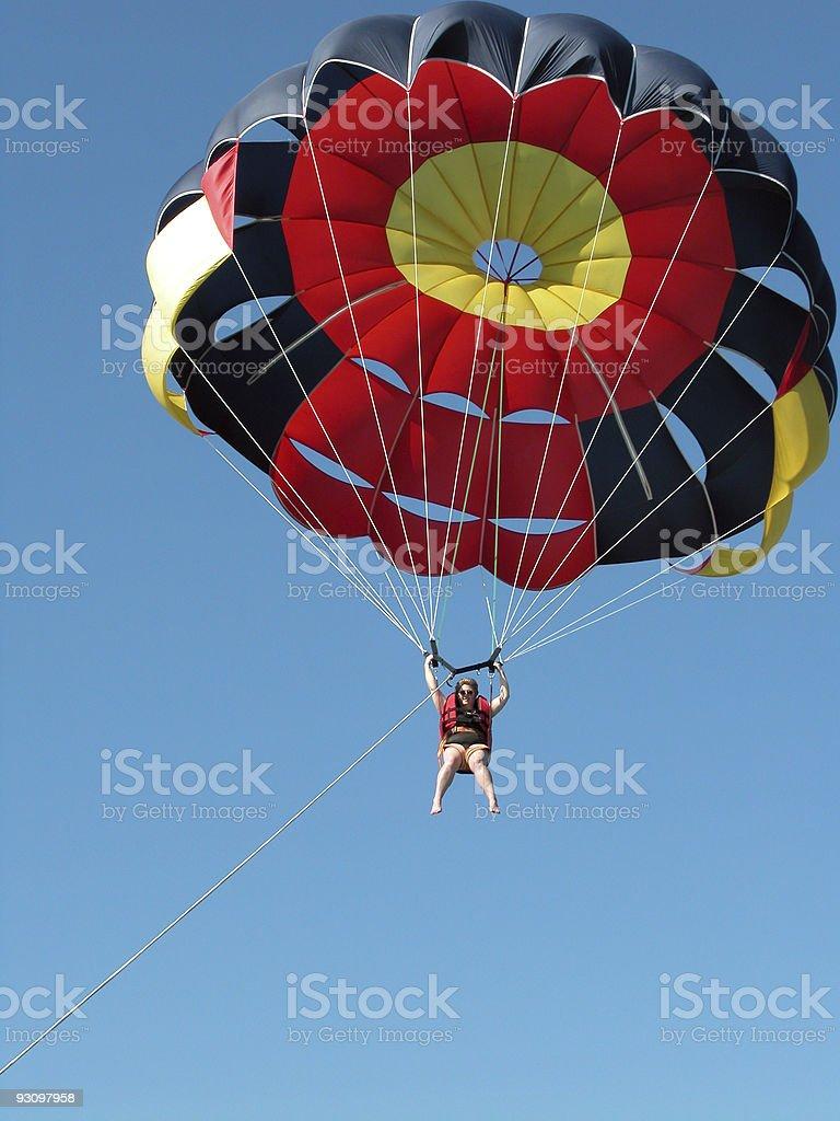 Woman parasailing stock photo