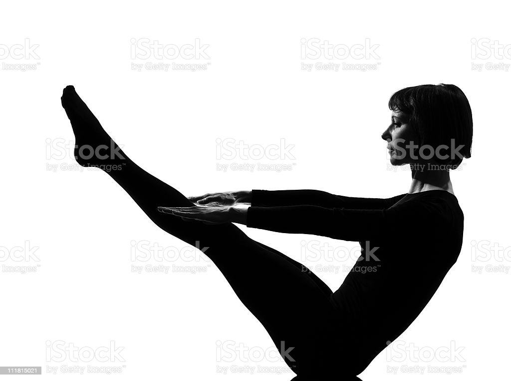 woman paripurna navasana boat pose yoga stock photo