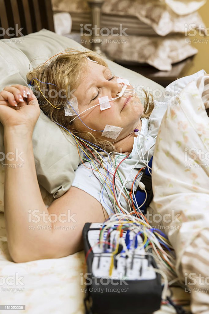 Woman participating in a sleep study stock photo