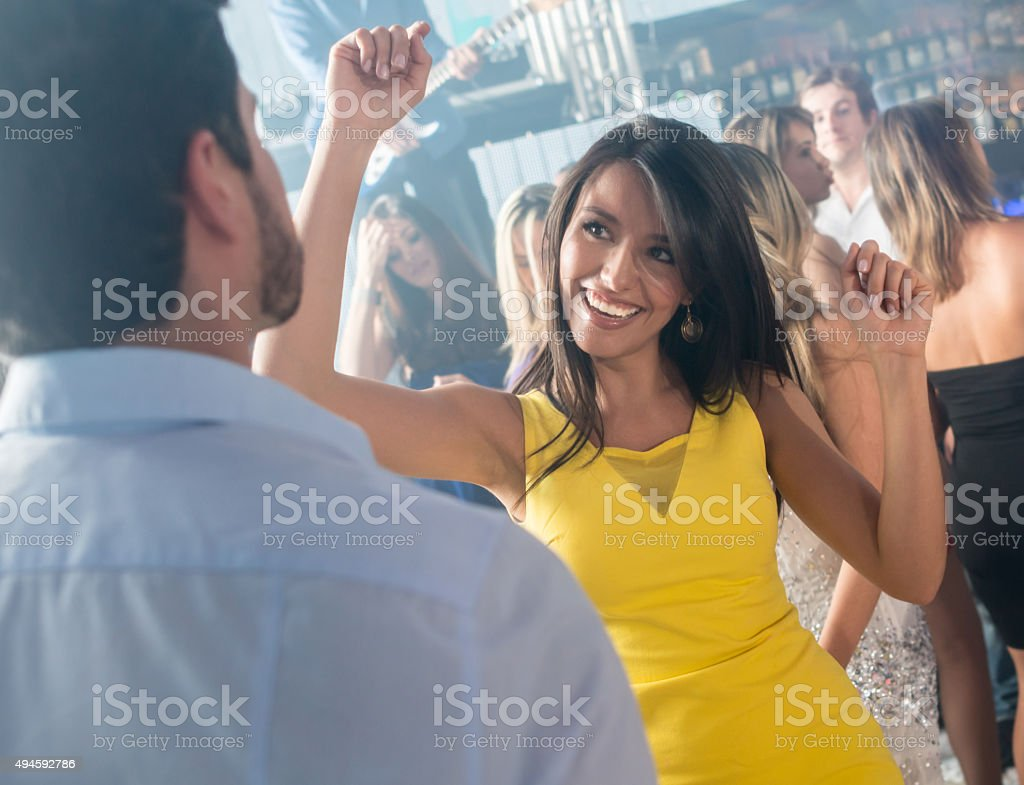 Woman partying at a nightclub stock photo