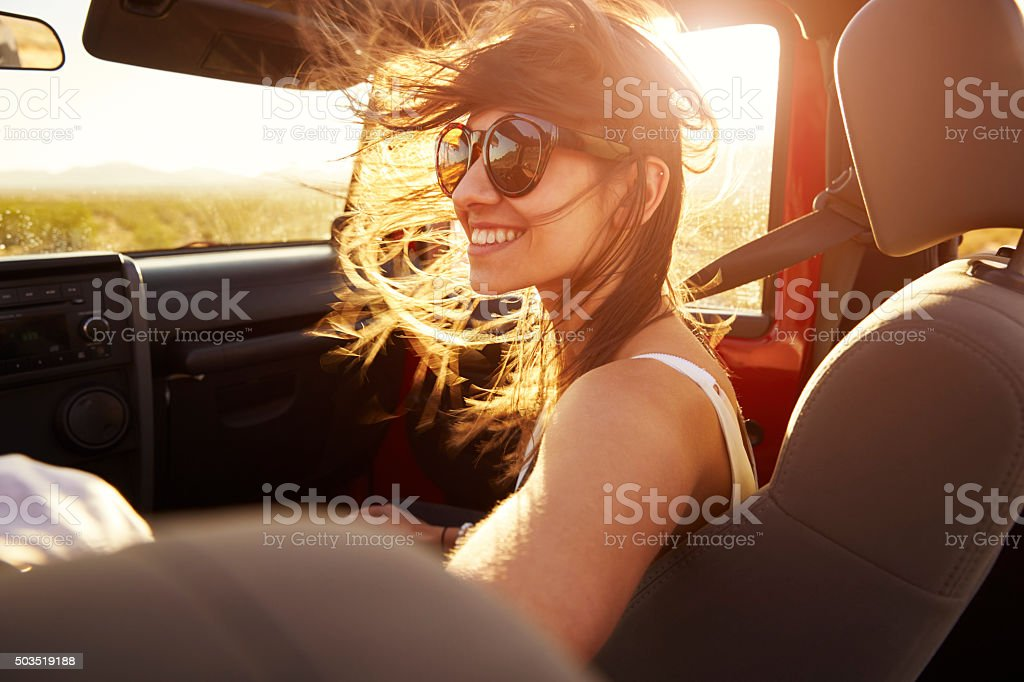 Woman Passenger On Road Trip In Convertible Car stock photo