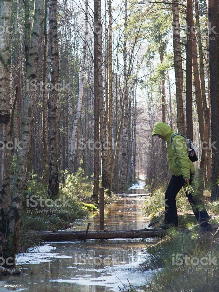 Woman passes a stream stock photo