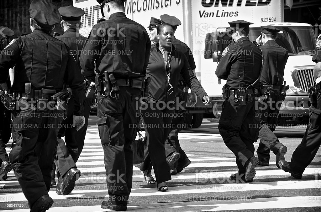 Woman passing NYPD Officers during United Nations Assembly events, NYC royalty-free stock photo