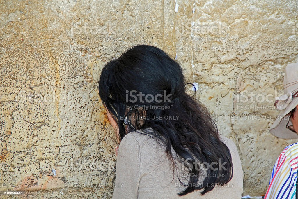 Woman Passionately Praying at the Western Wall stock photo