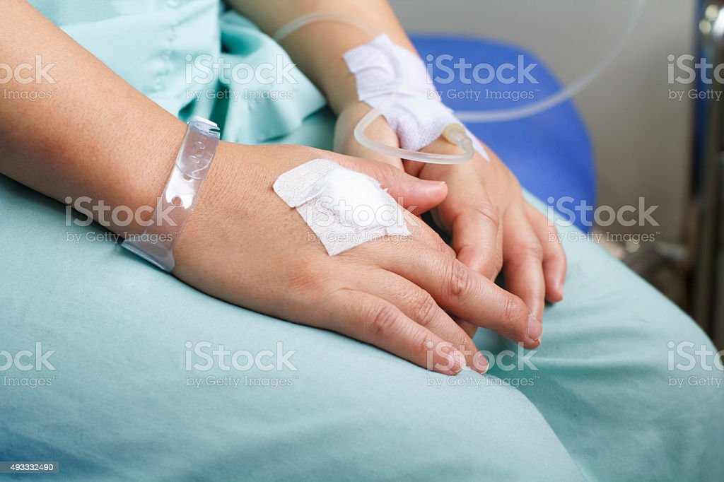 woman patient in hospital with saline intravenous stock photo