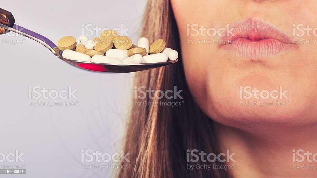 Woman patient not taking pills tablets. stock photo