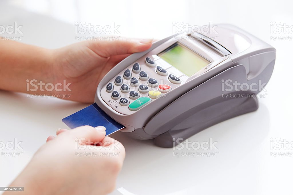 Woman pay by credit stock photo