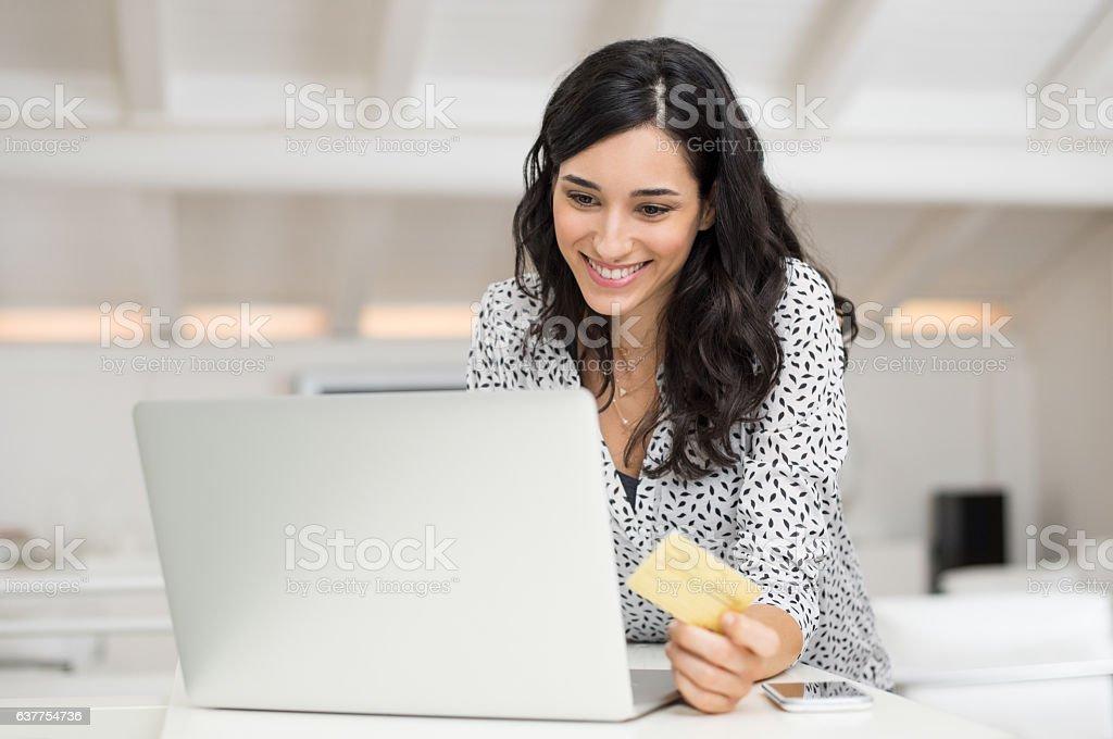 Woman paying bill online stock photo