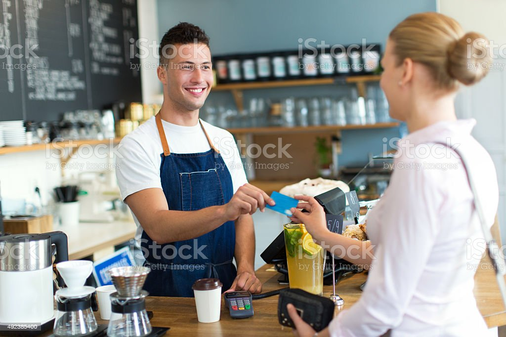 Woman paying for coffee stock photo