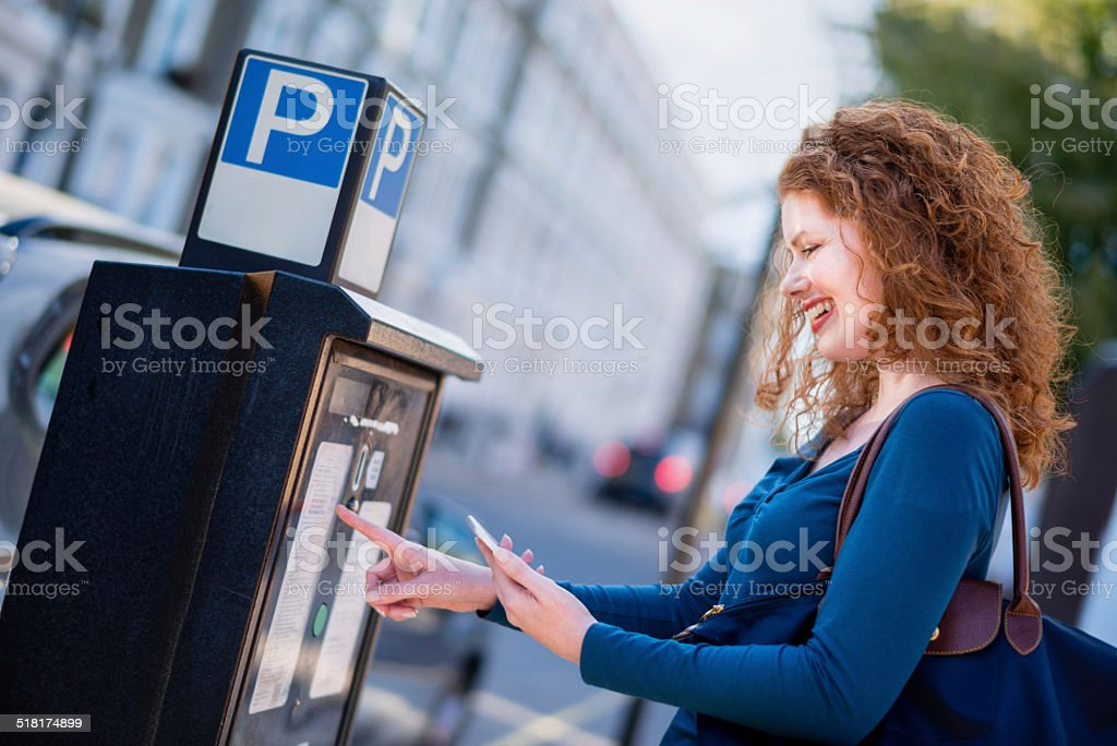Woman Paying for Parking stock photo