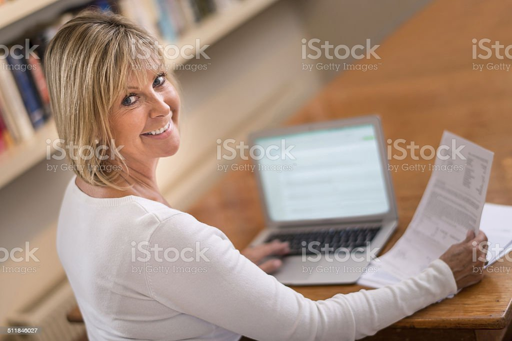 Woman paying the bills stock photo