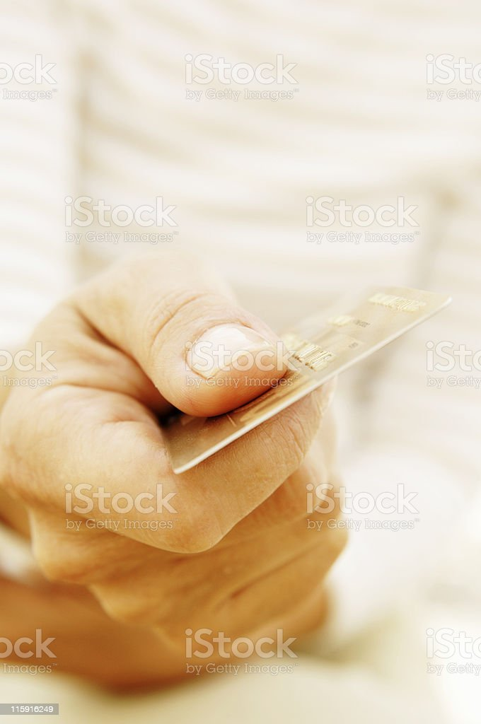 Woman paying with a credit card stock photo