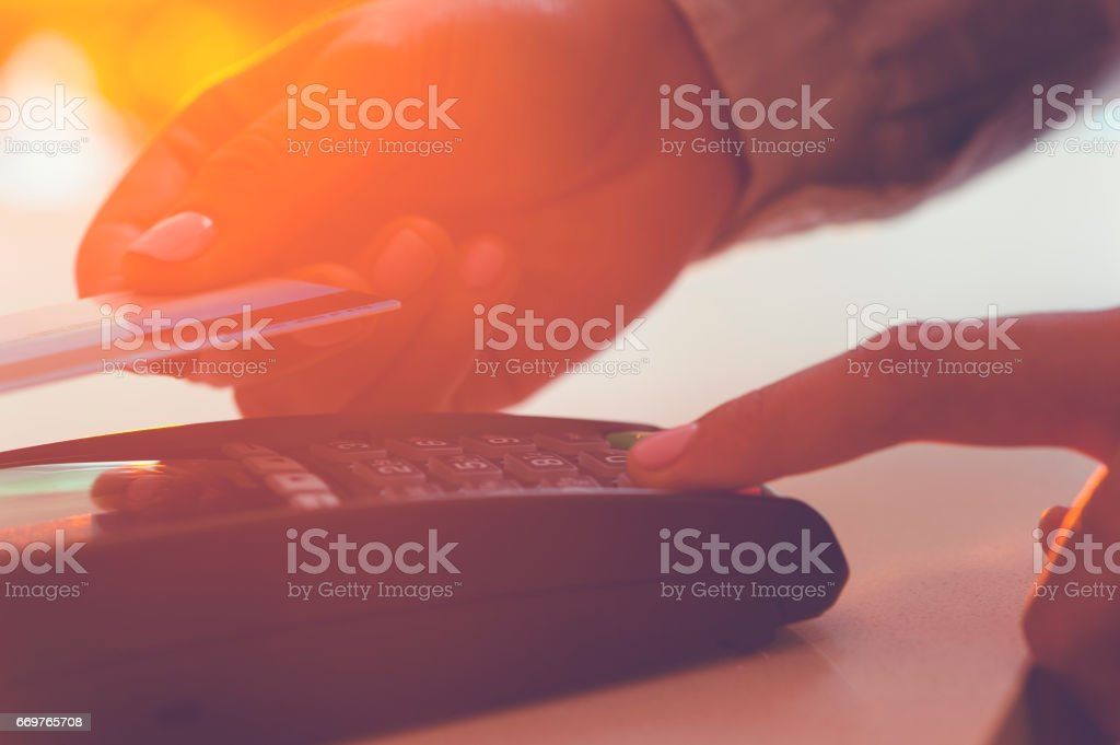 Woman paying with a credit card. stock photo
