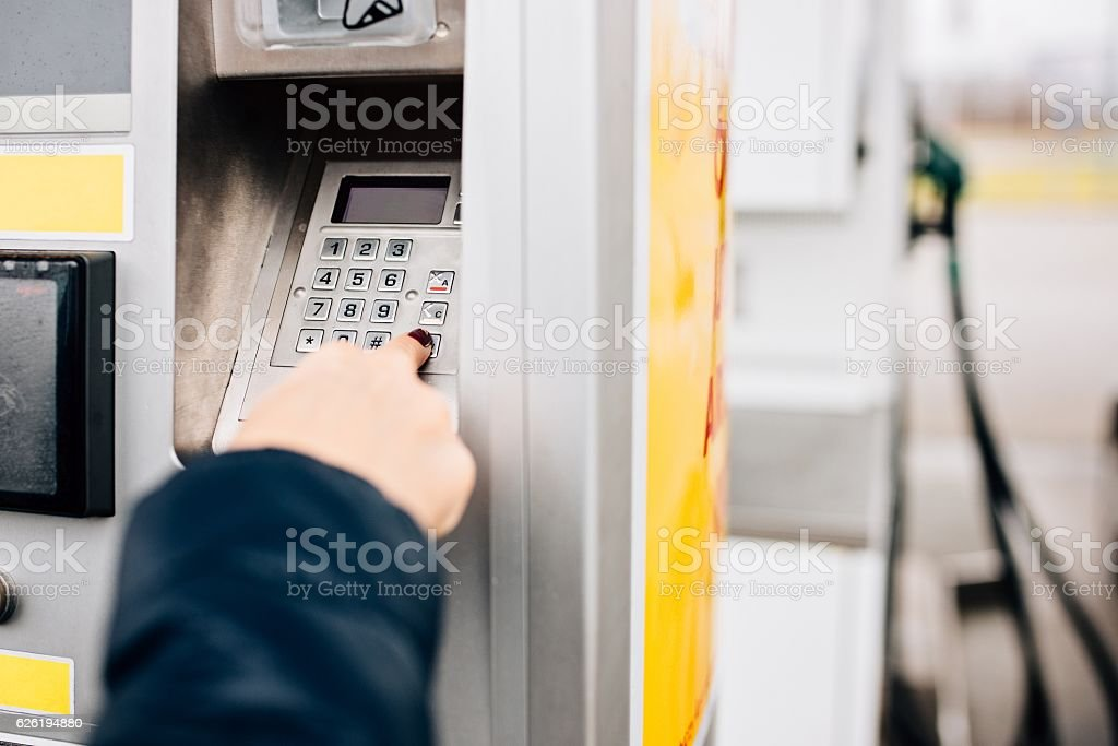Woman paying with credit card for fuel stock photo