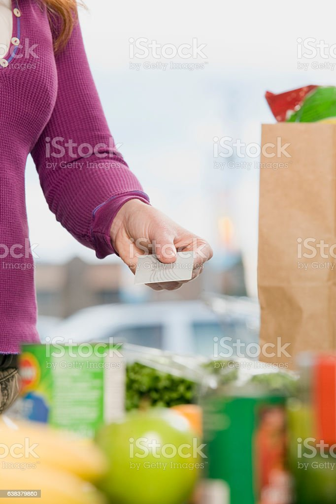 Woman paying with credit debit card at supermarket check out stock photo