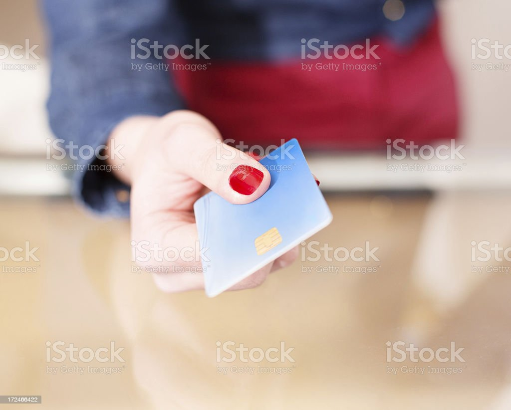 Woman paying with her credit card royalty-free stock photo