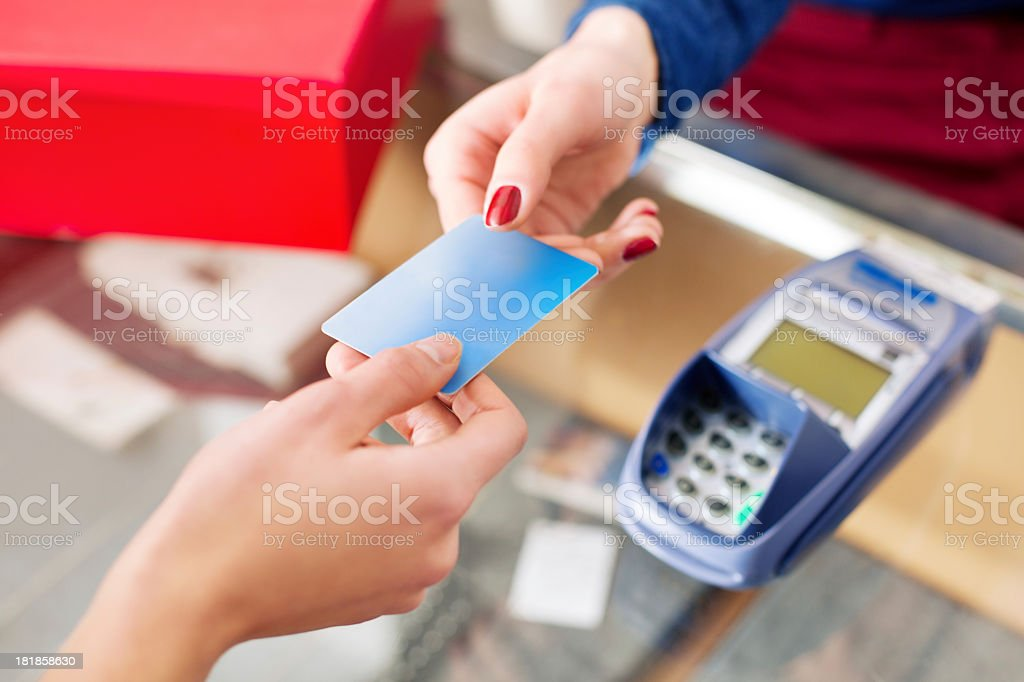 Woman paying with her credit card stock photo