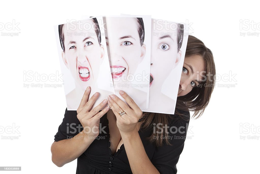 Woman Peeking From Behind Photos Of Her Emotions royalty-free stock photo