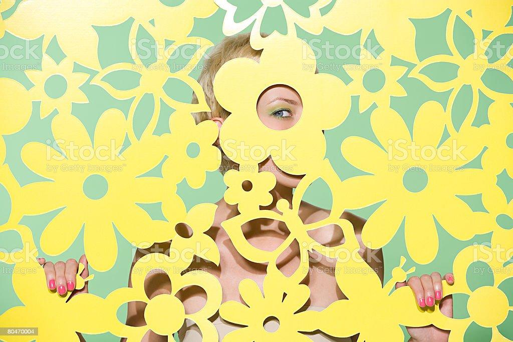 Woman peeking through cutout stock photo