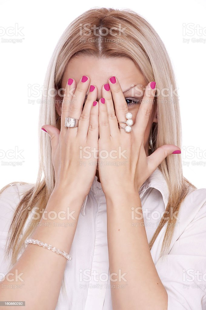 Woman peeking through fingers royalty-free stock photo