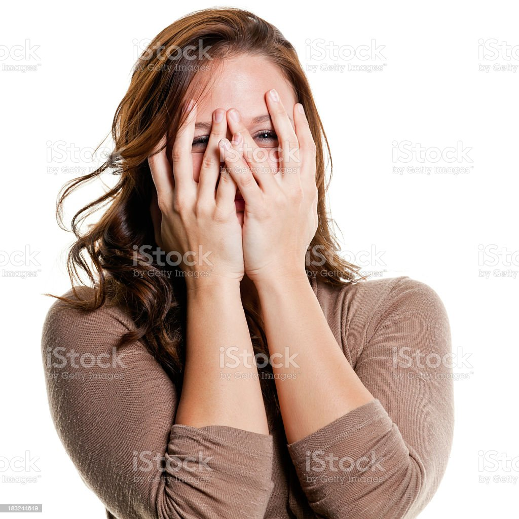 Woman Peeking Through Fingers stock photo