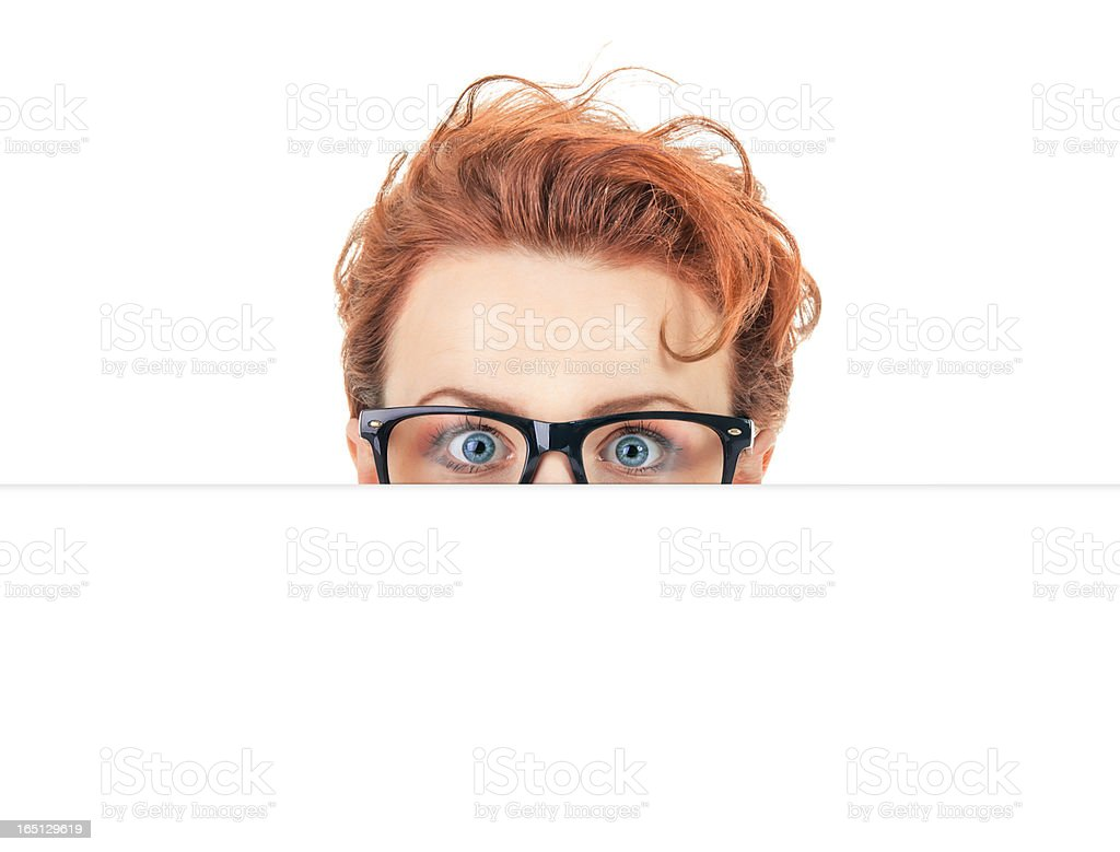 Woman peep out behind blank white board, hide situation royalty-free stock photo