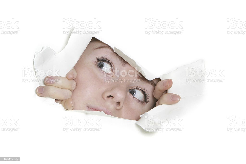 woman peeping through hole in paper royalty-free stock photo