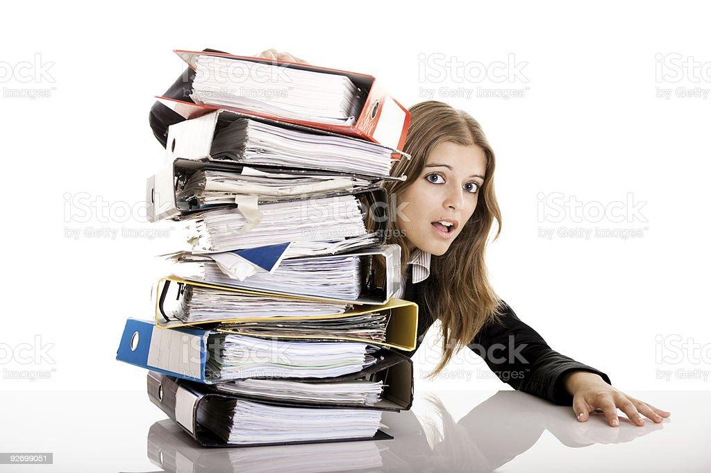 Woman peering from behind pile of folders royalty-free stock photo