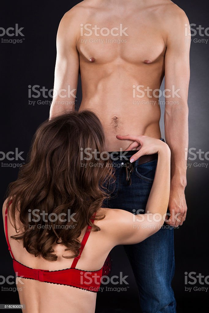 Woman Performing Oral Sex With Man stock photo