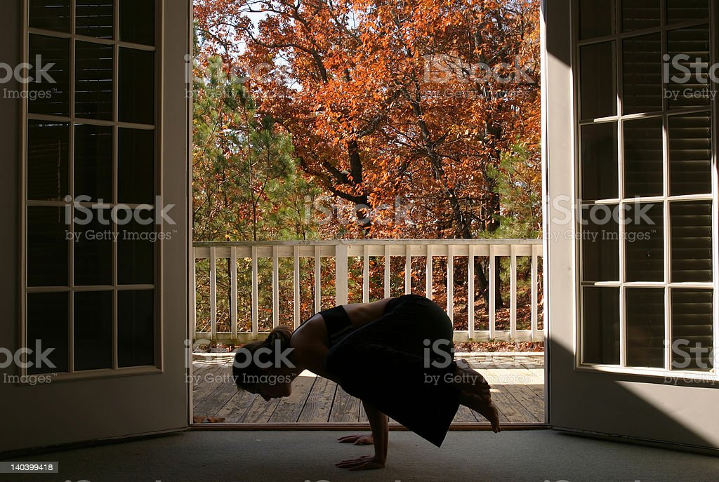 Woman performing yoga royalty-free stock photo