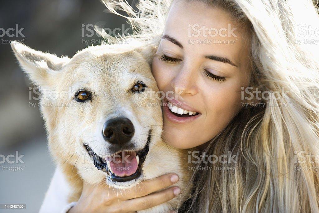 Woman petting dog. royalty-free stock photo