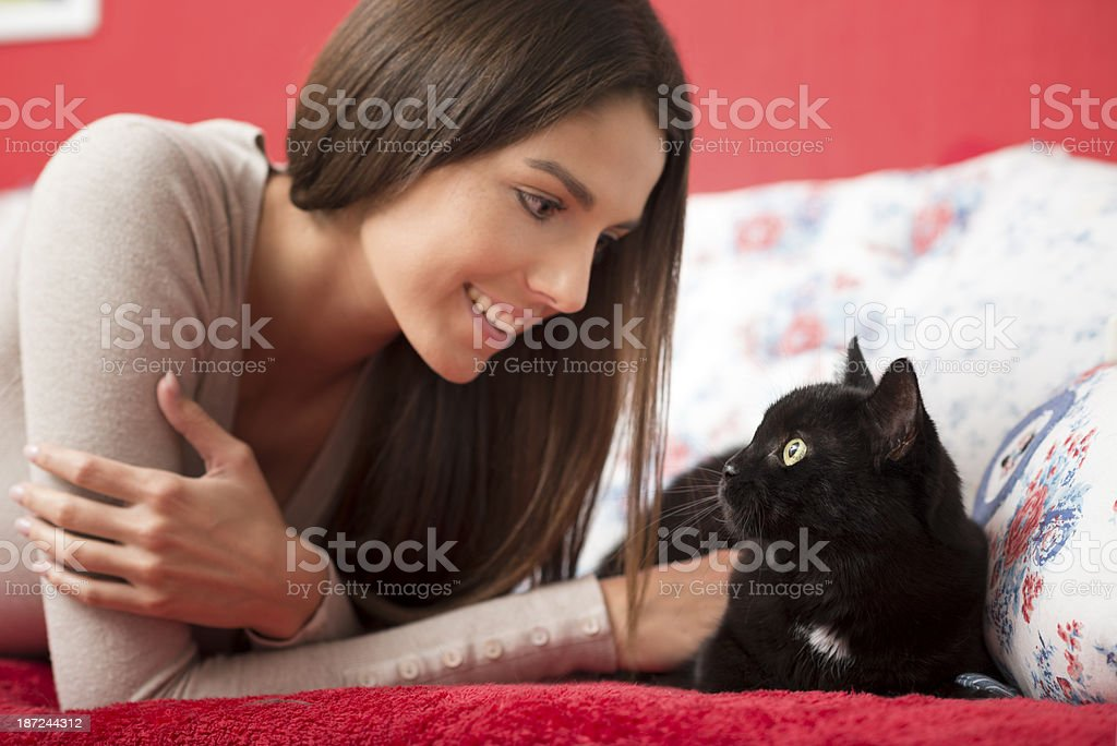 Woman petting her Black Cat royalty-free stock photo