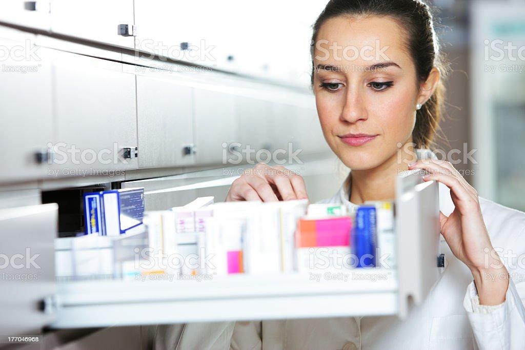 Woman pharmacist organizing medicines royalty-free stock photo