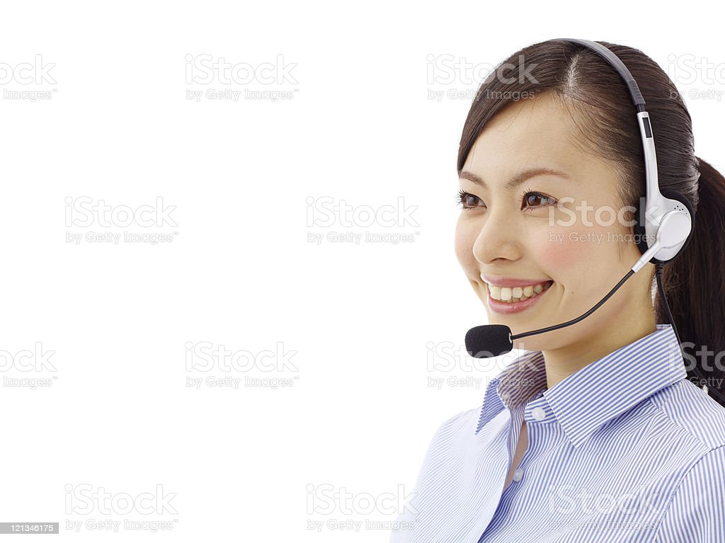 A woman phone operator in a shirt with a headset royalty-free stock photo