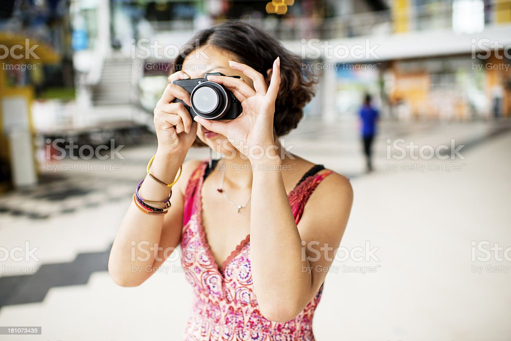 Woman Photographer at the Shopping Mall royalty-free stock photo