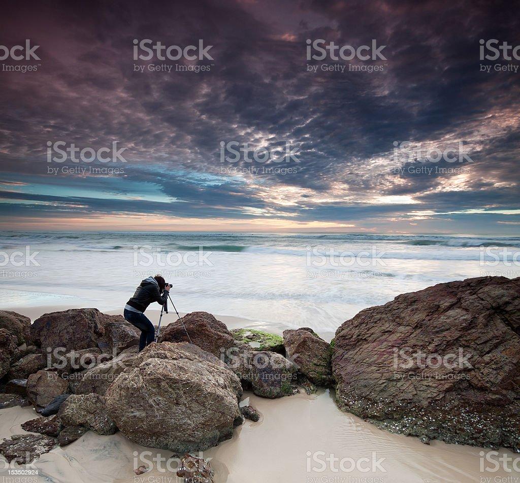 woman photographer takes photo of the seascape royalty-free stock photo