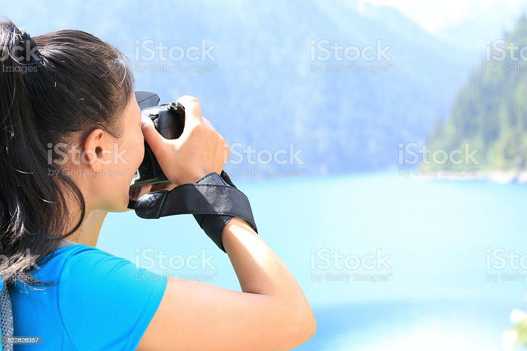 woman photographer taking photo in jiuzhaigou,china stock photo
