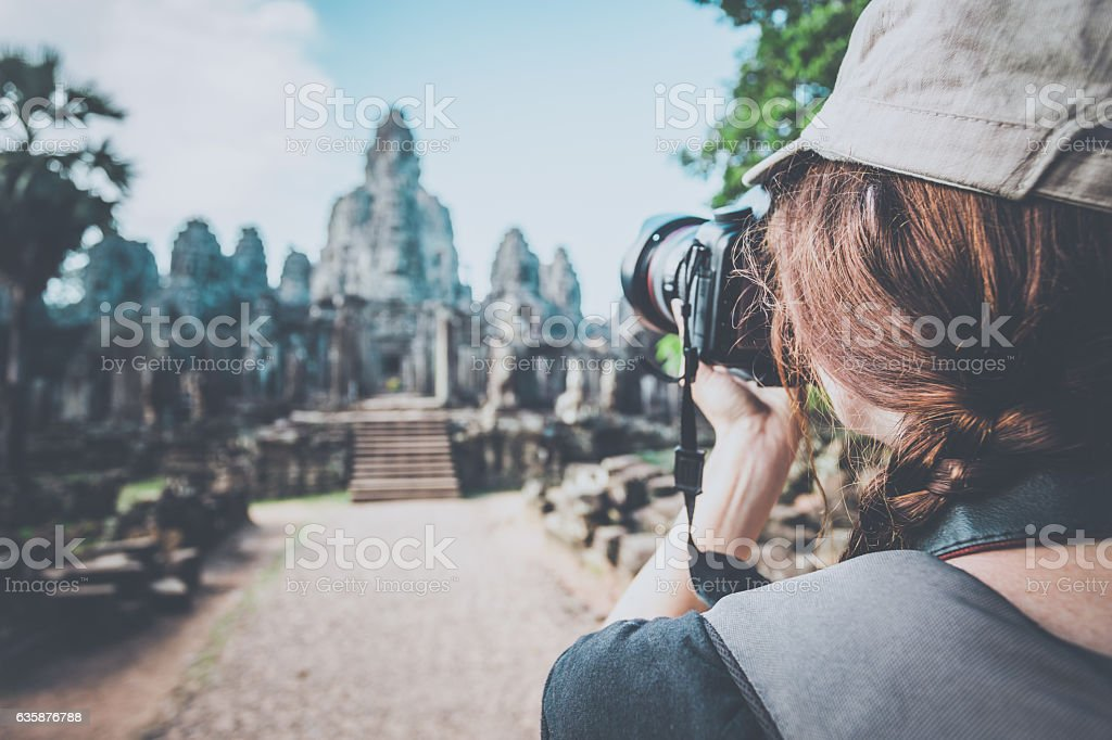 Woman Photographer Taking Picture at Angkor Wat, Cambodia stock photo