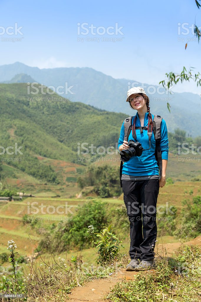 Woman Photographer Taking Picture in Rice Terraces stock photo