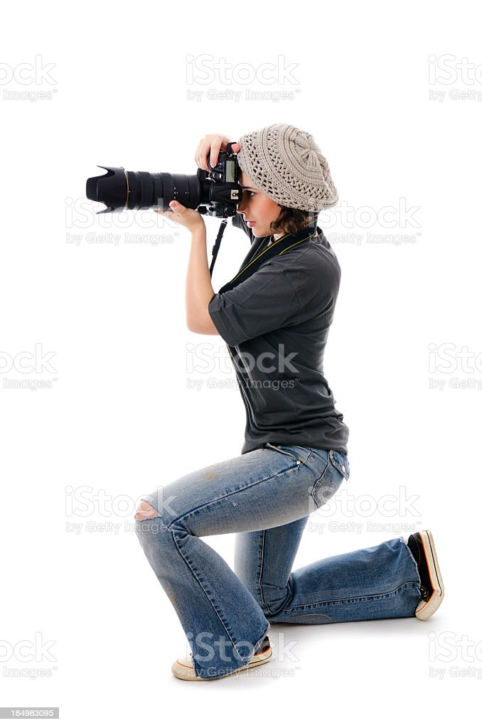Woman photographer with camera, isolated on white stock photo